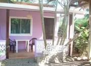 Se vende terreno con casa y cabinas